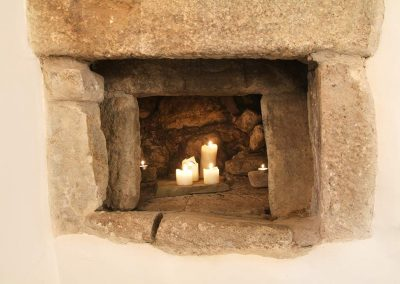 Granite old bread oven with lighted candles