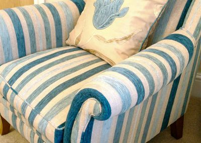 Blue stripped armchair in the Brentor bedroom