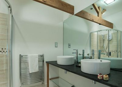 The dartmoor bathroom with twin basins and shower