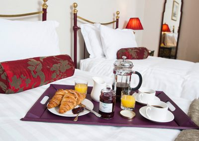 Breakfast tray on bed in Tavistock bedroom