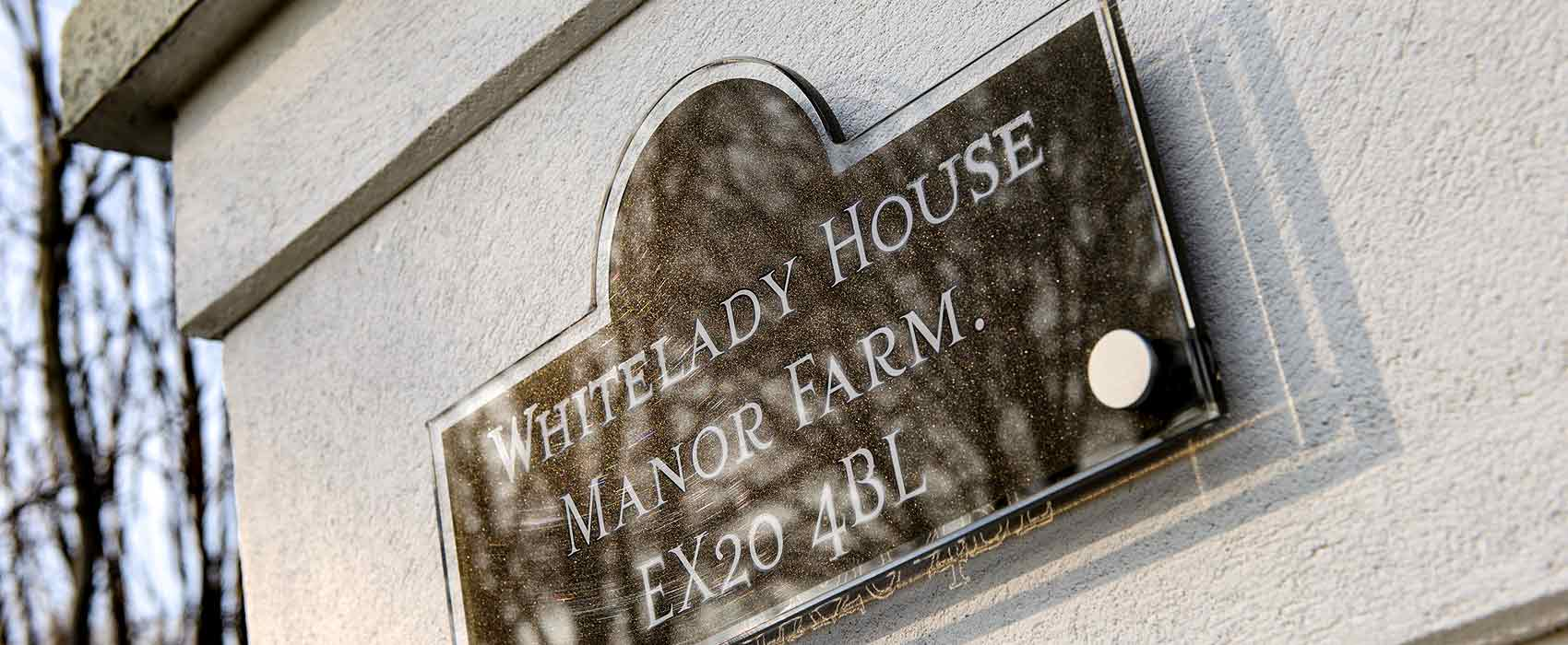 Whitelady sign on gatepost
